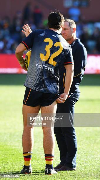 Don Pyke coach of the Adelaide Crows chats to Darcy Fogarty of the Adelaide Crows before the round 11 AFL match between the Adelaide Crows and the...