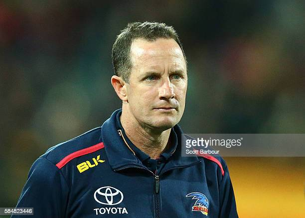 Don Pyke coach of the Crows speaks to his team during a quarter time break during the round 19 AFL match between the Adelaide Crows and the Essendon...