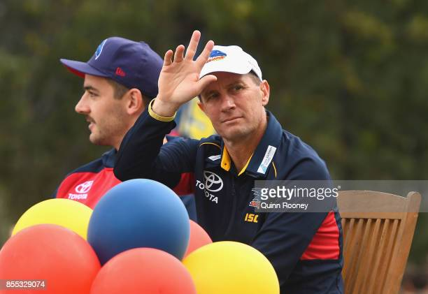 Don Pyke the coach of the Crows waves to the crowd during the 2017 AFL Grand Final Parade ahead of the Grand Final between the Adelaide Crows and the...
