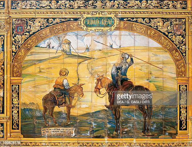 Don Quixote and Sancho Panza fighting the windmills in La Mancha azulejo in Plaza de Espana Seville Spain