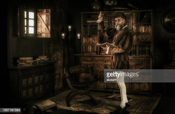 don quixote loosing his mind while reading chivalry books - 18th century stock pictures, royalty-free photos & images