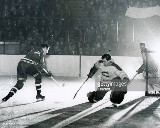 Don Raleigh of the Rangers beats Bill Durnan of the Canadiens 13049