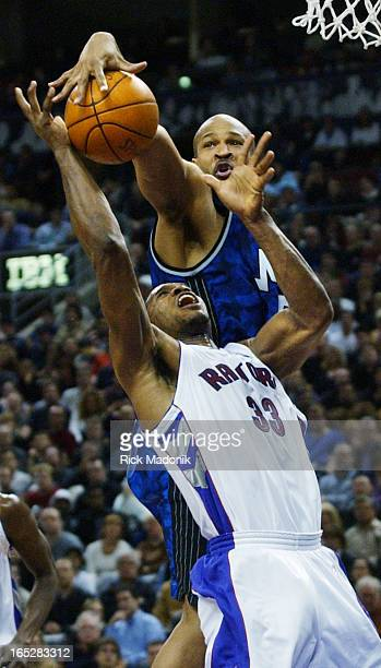 IMAGE 01/27/02 TORONTO ONTARIO Don Reid blocks Antonio Davis as well as getting called for a foul for contact during a NBA match up between the...
