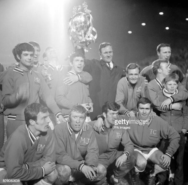Don Revie surrounded by his delighted players holds aloft the Football League Championship trophy after the presentation at Elland Road Leeds after...