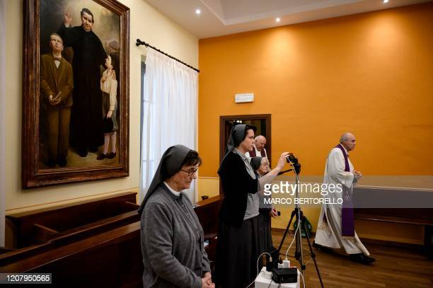 Don Roberto Salomone start to celebrate the streaming of Sunday mass in the Chapel of the San Giovanni Bosco Oratory on March 22 2020 in Saluzzo near...