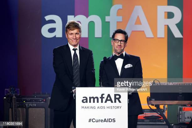 Don Roos and Dan Bucatinsky speak onstage during the 2019 amfAR Gala Los Angeles at Milk Studios on October 10, 2019 in Los Angeles, California.