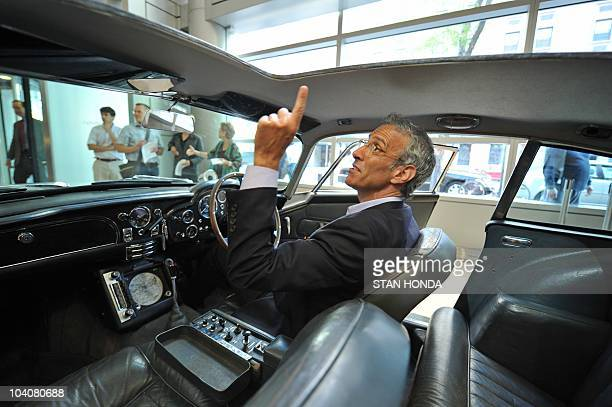 Don Rose a car specialist with RM Auctions describes the interior of the Aston Martin DB5 driven by actor Sean Connery as James Bond in the...