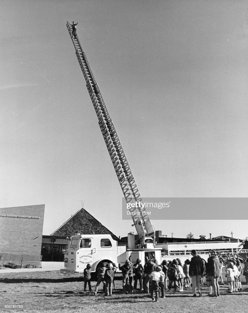 Don Roth is 80 feet high on extension ladder Credit: Denver