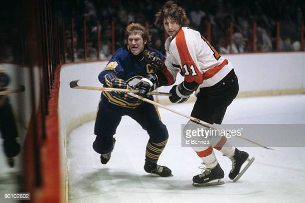 Don Saleski of the Philadelphia Flyers skates against Jim Schoenfeld of the Buffalo Sabres during a circa 1970's game at the Spectrum in Philadelphia...