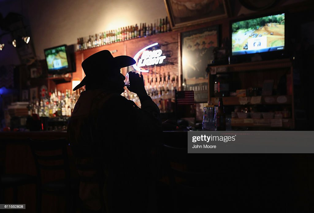Don 'Scottie' Scott, 71 and retired, drinks and watches television at the Doc Hollidays Saloon on September 29, 2016 in Benson, Arizona. Tombstone was once the last wide-open frontier town in the American West, now mostly profits from sales of souvenirs to tourists and puts on daily re-enactments of the Gunfight at the OK Corral.