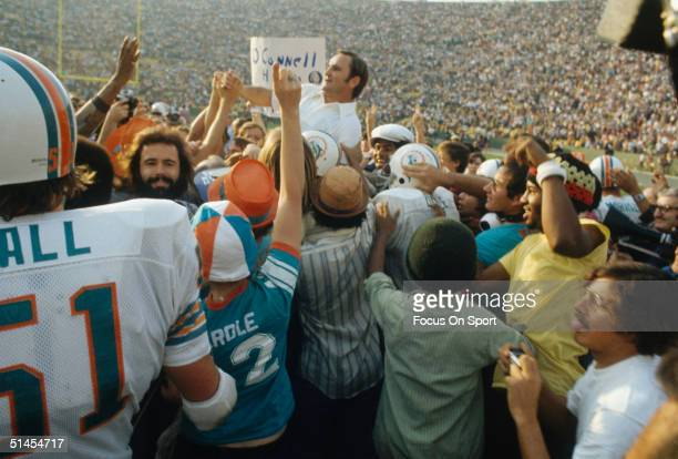 Don Shula coach of the Miami Dolphins is carried off the field by his team while celebrating victory against the Washington Redskins during the Super...