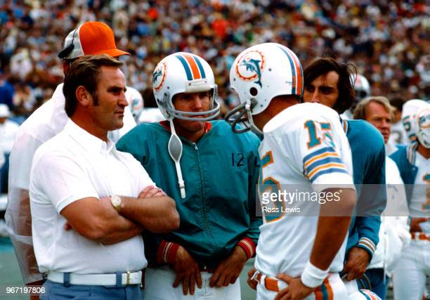 Don Shula Coach of the Miami Dolphins speaks with Quarterback Bob Griese and Quarterback Earl Morrall during an NFL football game against the...