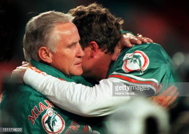 Don Shula hugs Dan Marino after Marino was honored for breaking three standing passing records previously held by the Minnesota Viking's Fran...