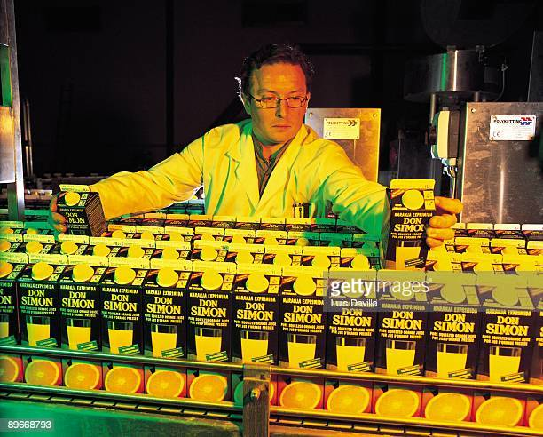 Don Simon juice factory A worker selects the container of tetrabrick