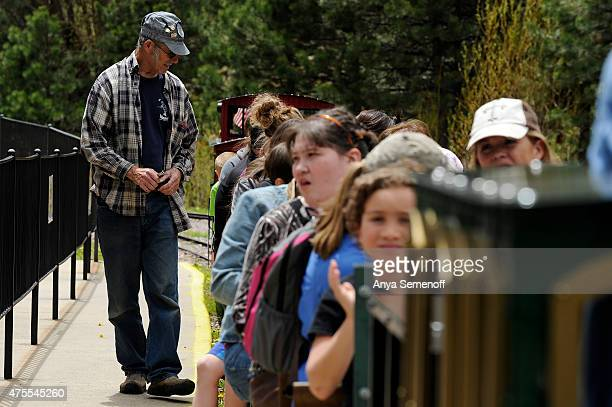Don Smith punches train tickets at Tiny Town on May 26 in Jefferson County, Colorado. Tiny Town & Railroad originally opened in 1915, and will be...