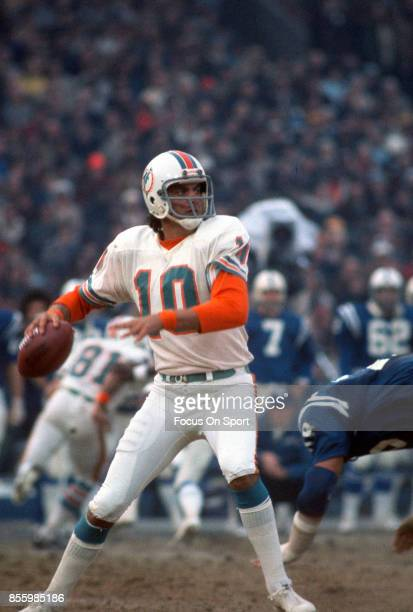 Don Strock of the Miami Dolphins drops back to pass against the Baltimore Colts during an NFL football game December 14 1975 at Memorial Stadium in...