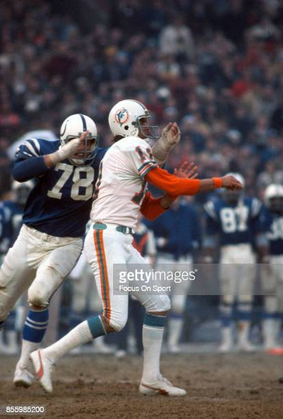 Don Strock of the Miami Dolphins gets his pass off under pressure from John Dutton of the Baltimore Colts during an NFL football game December 14...