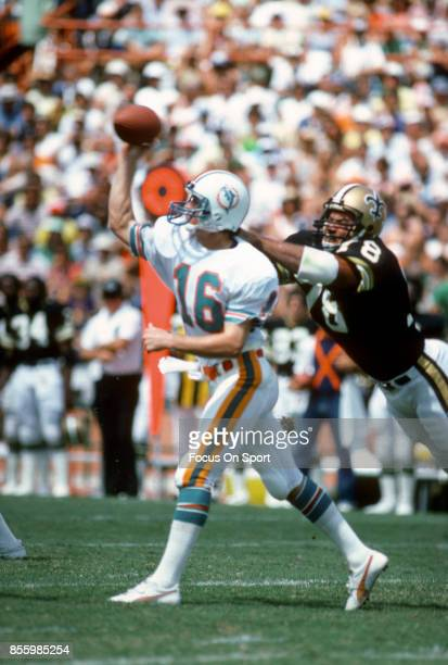 Don Strock of the Miami Dolphins gets his pass off under pressure from Elois Grooms of the New Orleans Saints during an NFL football game September...