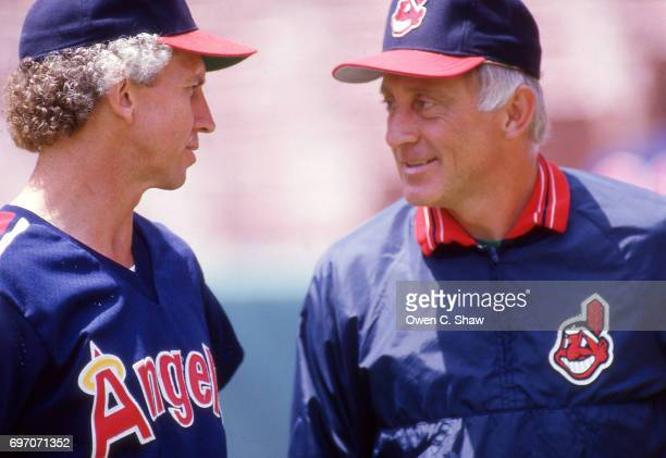 Don Sutton of the California Angels talks to Phil Niekro of the Cleveland Indians prior to a game at the Big A circa 1986 in Anaheim California