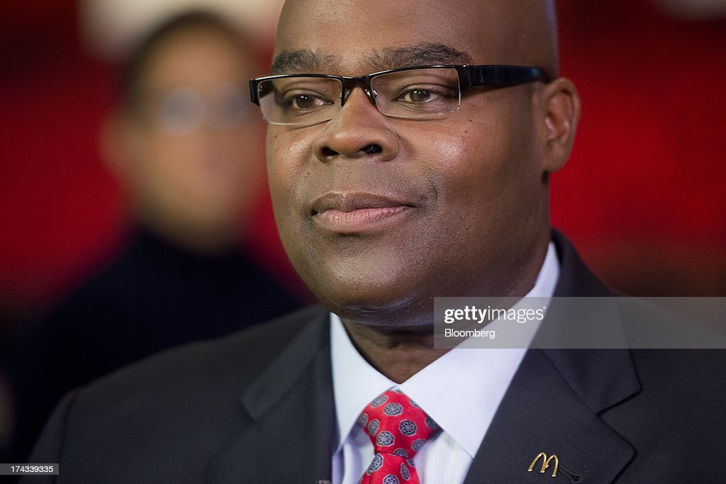 Don Thompson, president and chief executive officer of McDonald's Corp., listens during a Bloomberg Television interview at McDonald's headquarters in Oak Brook, Illinois, U.S., on Wednesday, July 24, 2013. Thompson said the company is an 'above minimum-wage employer' and will continue to provide entry-level jobs. Photographer: Daniel Acker/Bloomberg via Getty Images