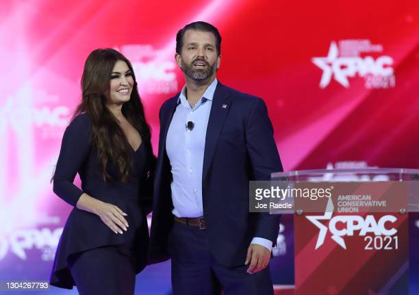 Don Trump, Jr. And Kimberly Guilfoyle stand on stage as they address the Conservative Political Action Conference being held in the Hyatt Regency on...