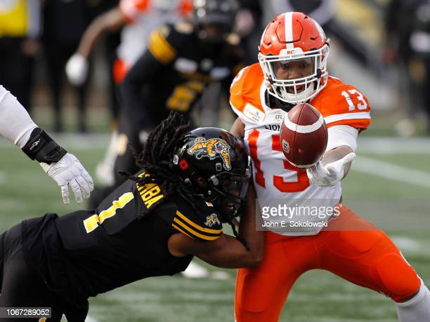 Don Unamba of the Hamilton TigerCats defends a pass to Tyrell Sutton of the BC Lions during the Eastern SemiFinal game at Tim Hortons Field on...