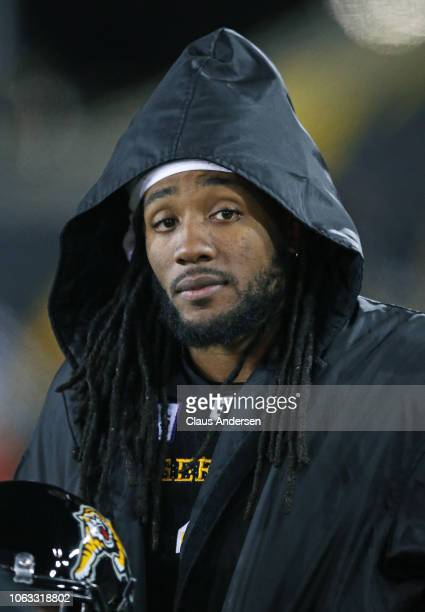 Don Unamba of the Hamilton TigerCats watches from the sidelines against the Montreal Alouettes in a CFL game at Tim Hortons Field on November 3 2018...