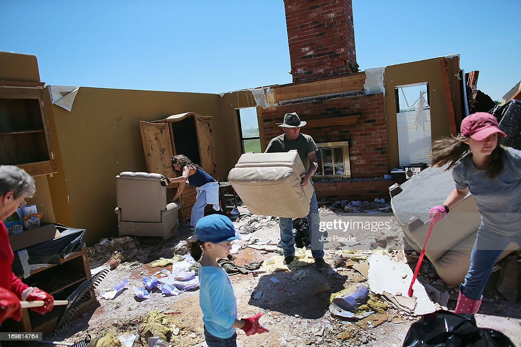 Don Wade (C) along with family and friends salvage what they can from his son's home after it was destroyed by a tornado on June 2, 2013 in El Reno, Oklahoma. The tornado ripped through the area friday killing at least 9 people, injuring many and destroying homes and buildings.