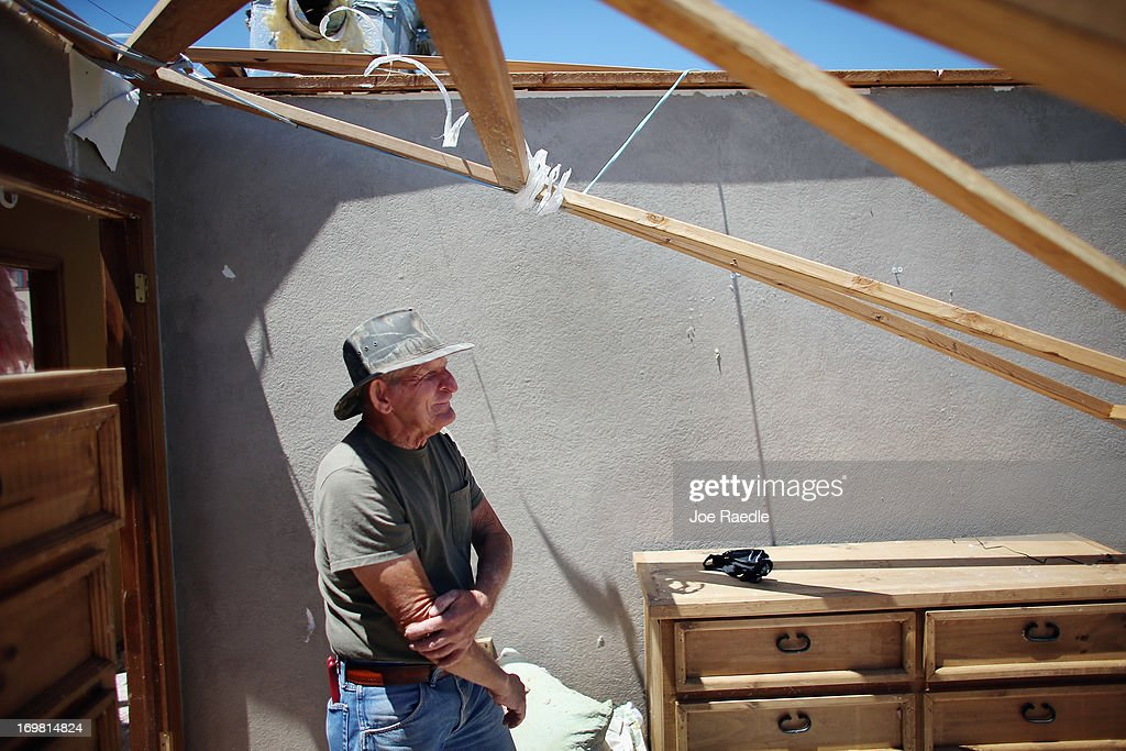 Don Wade stands in what is left of a bedroom in his son's home after it was destroyed by a tornado on June 2, 2013 in El Reno, Oklahoma. The tornado ripped through the area friday killing at least 9 people, injuring many and destroying homes and buildings.