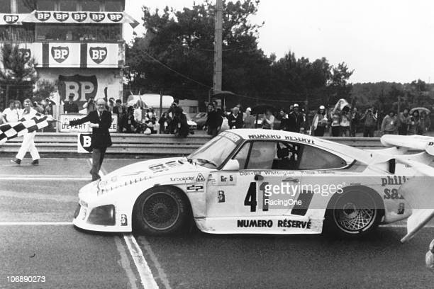 Don Whittington takes the checkered flag to win the running of the 24 Hours of Le Mans. Whittington co-drove his Porsche 935 K3 to the victory with...