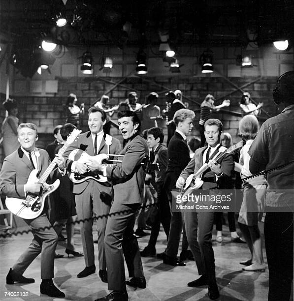 Don Wilson Mel Taylor Nokie Edwards and Bob Bogle of the rock and roll band The Ventures perform onstage on the TV show American Bandstand with...
