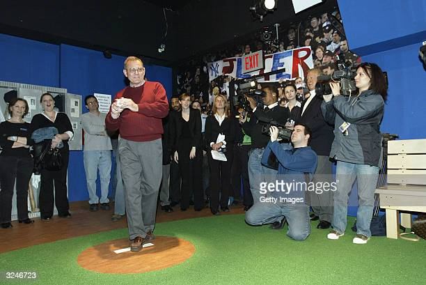 Don Zomer Derek Jeter's high school coach from Kalamazoo Central High throws out the first pitch at the launch of a new interactive experience...