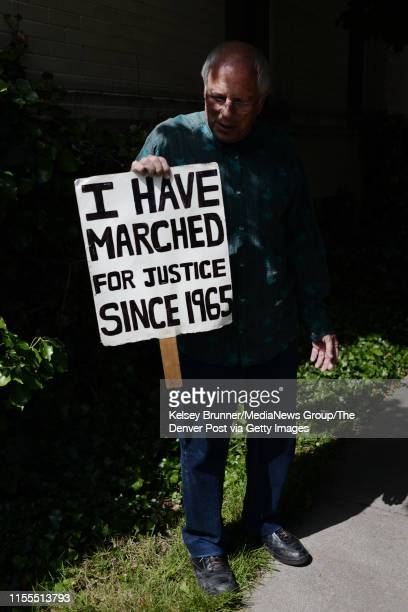 Donaciano Martinez looks down at his handmade sign in his front yard in Denver Colorado on Wednesday June 12 2019 Martinez has marched in the Denver...