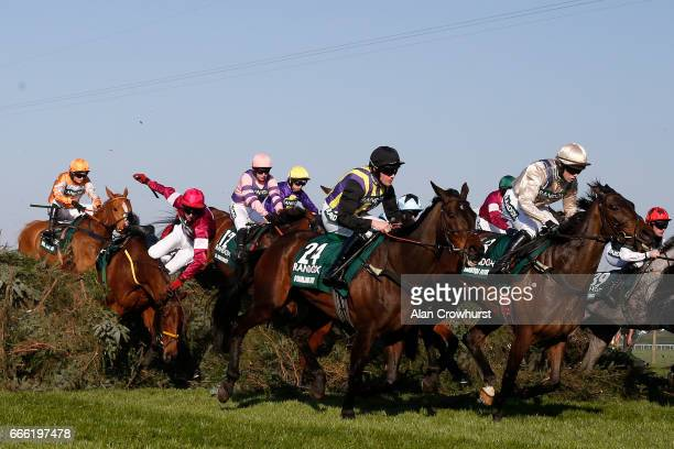 Donagh Meyler riding Measureofmydreams falls at 'The Chair' during The Randox Health Grand National at Aintree Racecourse on April 8 2017 in...