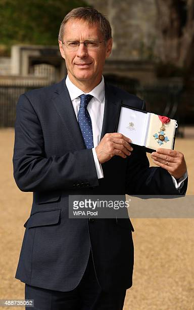 Donal Brown poses after receiving an CBE for services to International Development during an Investiture ceremony at Windsor Castle on September 17...