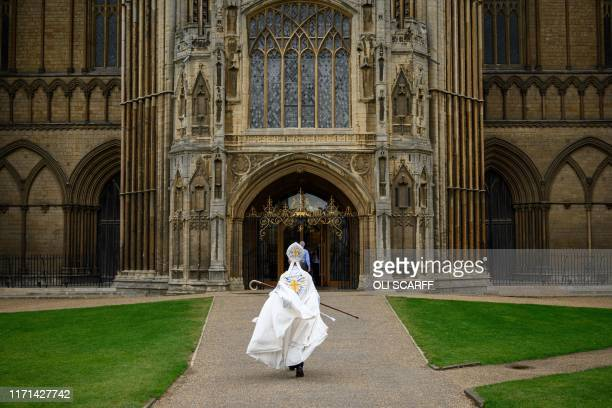 Donald Allister the Bishop of Peterborough enters the Gothic 'West Front' of Peterborough cathedral in Peterborough central England on September 26...