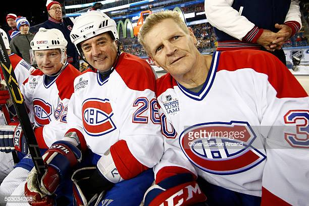 Donald Audette Norman Dupont and Chris Nilan of the Montreal Canadiens on the bench against the Boston Bruins in the alumni game on December 31 2015...
