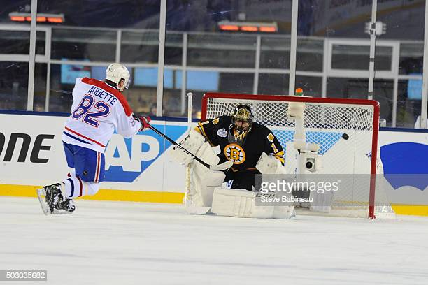 Donald Audette of the Boston Bruins scores in a shootout Andrew Raycroft of the Boston Bruins in the alumni game December 31 2015 during 2016...