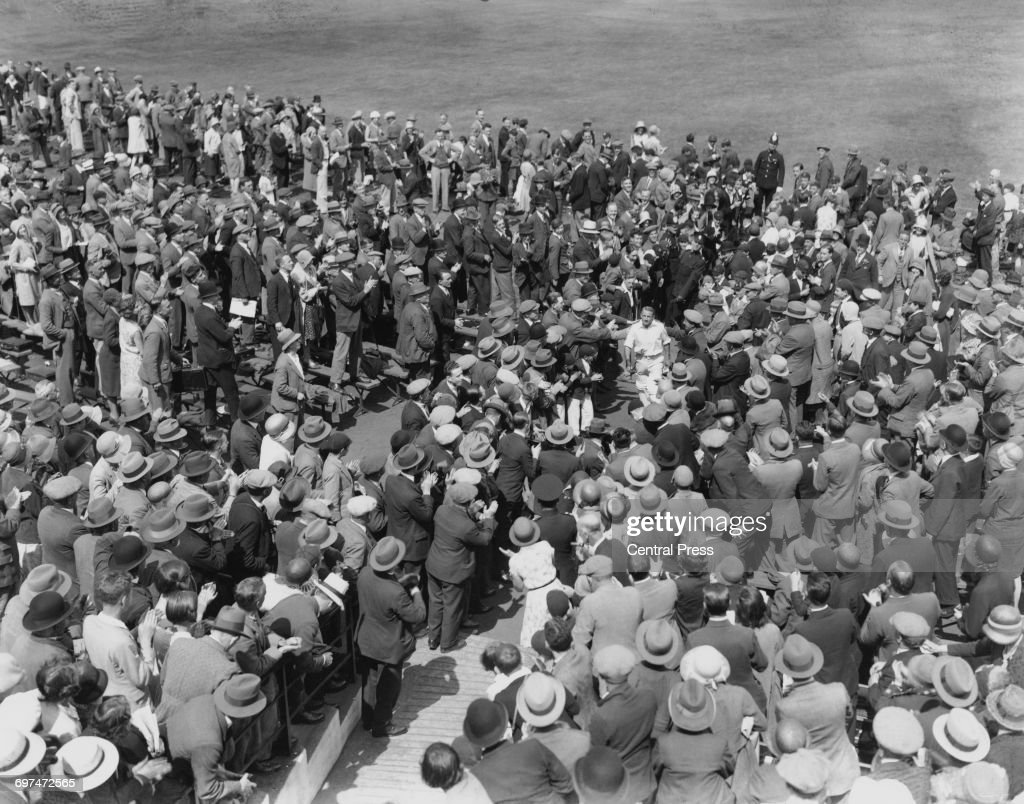 Donald Bradman of Australia returns to the pavillion amidst the congratulations of the spectators in the grandstand after his record scoring of 334 runs during Australia's first innings of the third Test match of The Ashes series between England and Australia on 12 July 1930 at the Headingley Cricket Ground, Leeds, United Kingdom. (Photo by Central Press/Hulton Archive/Getty Images).