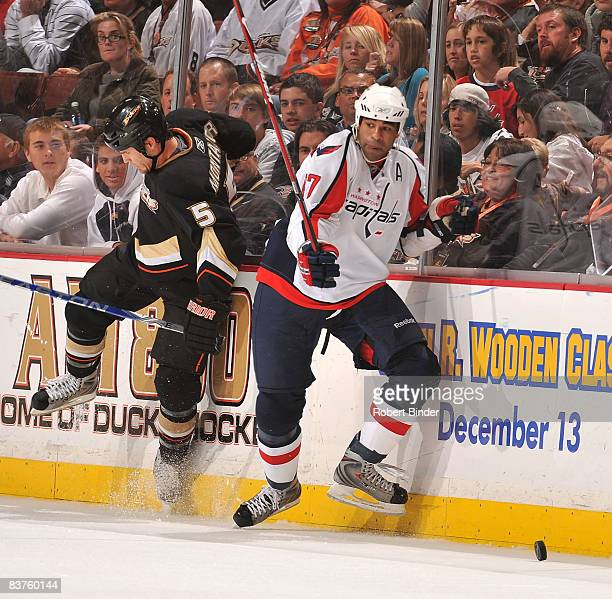 Donald Brashear of the Washington Capitals battles for the puck along the boards against Steve Montador of the Anaheim Ducks in NHL action November...