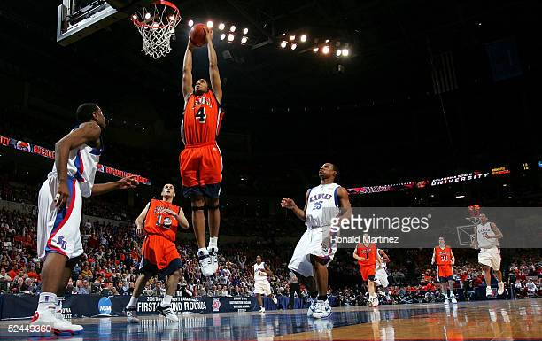 Donald Brown of the Bucknell Bison goes up for a dunk in the first half against the Kansas Jayhawks during the first round of the NCAA Men's...
