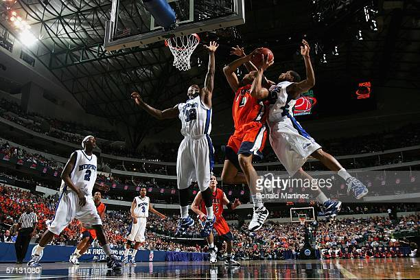 Donald Brown of the Bucknell Bison goes up for a shot between Joey Dorsey and Antonio Anderson of the Memphis Tigers during the Second Round game of...