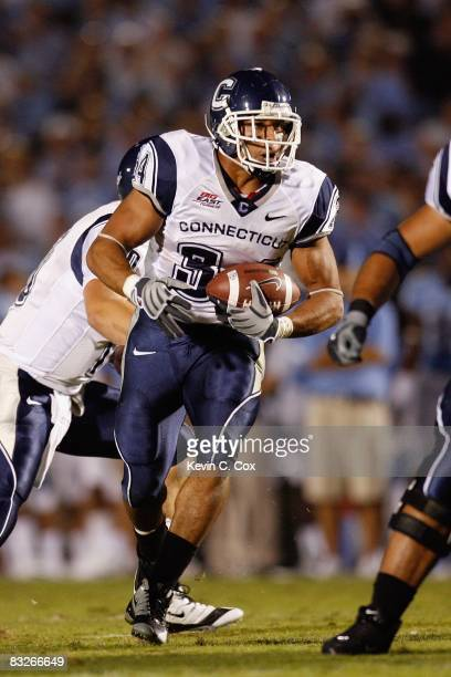 Donald Brown of the Connecticut Huskies carries the ball during the game against the North Carolina Tar Heels at Kenan Stadium on October 4 2008 in...