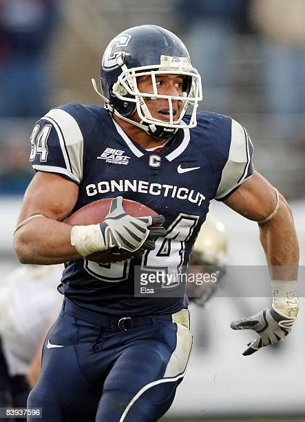 Donald Brown of the Connecticut Huskies carries the ball in the second half against the Pittsburgh Panthers on December 6 2008 at Rentschler Field in...