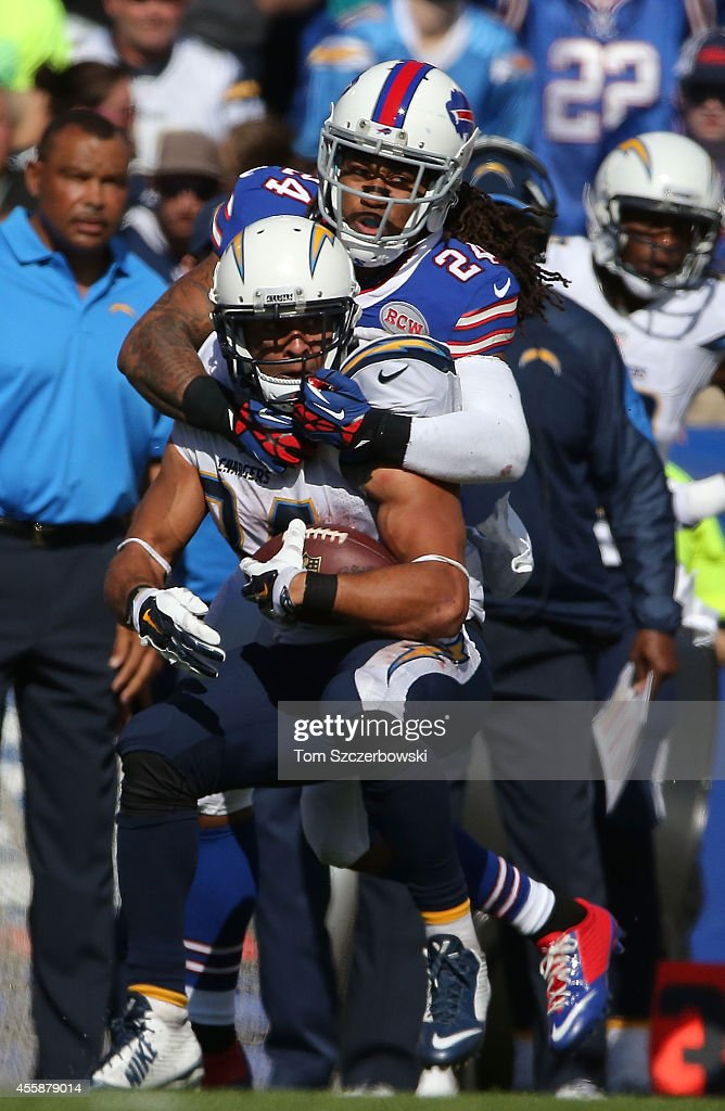 Donald Brown #34 of the San Diego Chargers is tackled by Stephon Gilmore #24 of the Buffalo Bills during the second half at Ralph Wilson Stadium on September 21, 2014 in Orchard Park, New York.