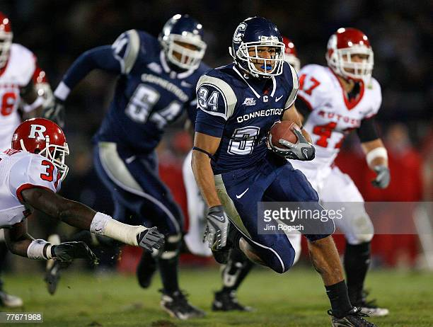 Donald Brown of University of Connecticut Huskies gains yardage against the Rutgers Scarlet Knights at Rentschler Field November 3, 2007 in East...