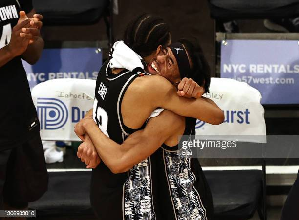Donald Carey and Dante Harris of the Georgetown Hoyas hug after the win over the Creighton Bluejays during the Big East Championship game at Madison...