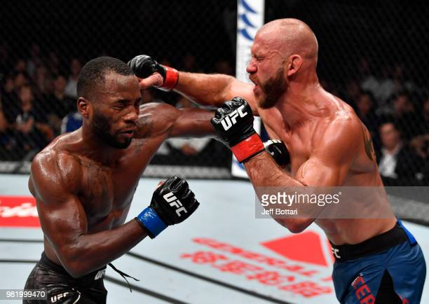 Donald Cerrone and Leon Edwards of Jamaica trade punches in their welterweight bout during the UFC Fight Night event at the Singapore Indoor Stadium...