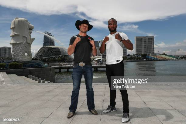 Donald Cerrone and Leon Edwards pose for a photo at the Merlion Park overlooking Marina Bay on April 25 2018 in Singapore