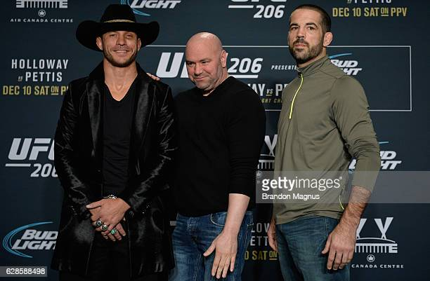 Donald Cerrone and Matt Brown pose for a picture during the UFC 206 Ultimate Media Day event inside the Westin Harbour Castle Hotel on December 8,...